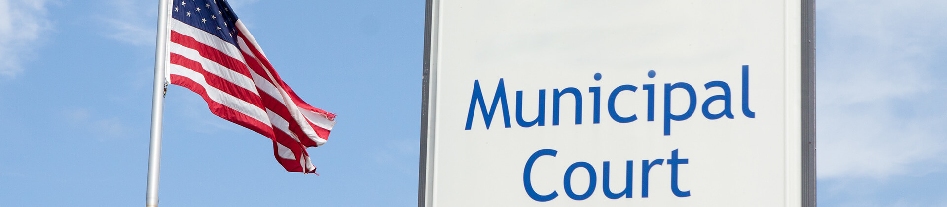 Municipal court sign with American flag